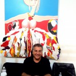 Bob Ore at Boa Gallery, Beverly Hills, CA, in front of a Malka Nedivi painting