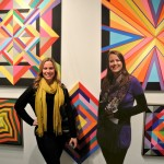 Me and my dear friend Kristin Darlington Dunlavy, against a wall of art by Michael Griesgraber